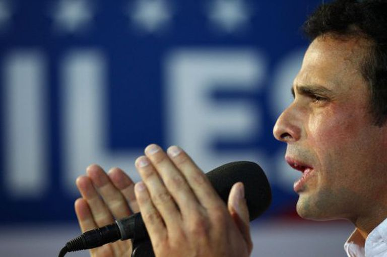 Venezuela's opposition leader Henrique Capriles talks to the media during a news conference in Caracas on April 24, 2013.