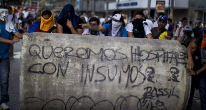 A group of demonstrators hold a march in Caracas on Sunday.