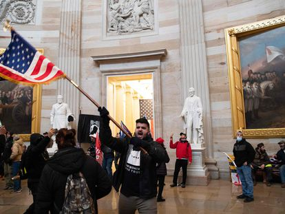 Supporters of US President Donald Trump protesting inside the US Capitol on January 6 after breaching security.