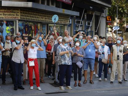 A group of tourists in Barcelona on Friday.
