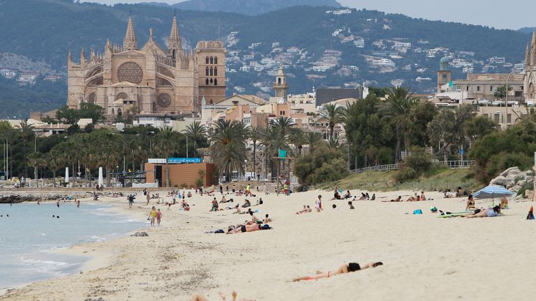 Beachgoers in Mallorca in Spain's Balearic Islands on Monday.