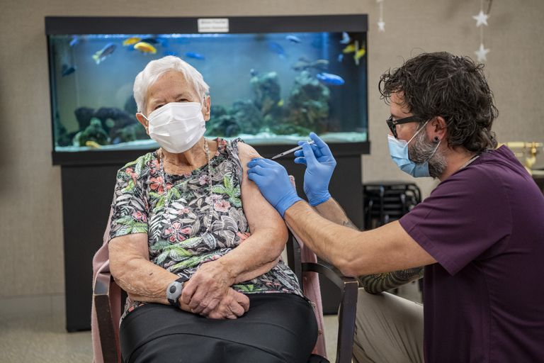A woman in Lucerne, Switzerland receiving the Pfizer-BioNTech vaccine on Wednesday.