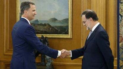 King Felipe greets Mariano Rajoy in July.