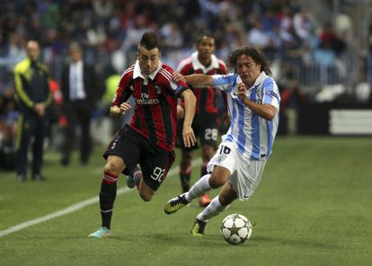 Stephan El Shaarawy vies for the ball with Manuel Iturra during Málaga's 1-0 win in La Rosaleda two weeks ago.