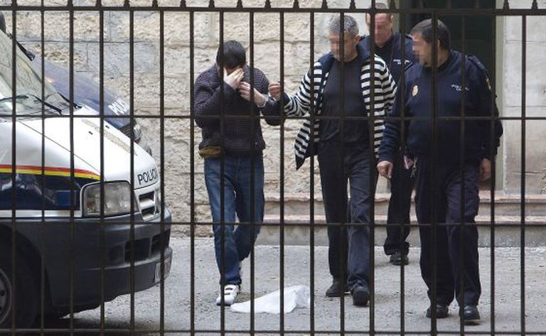 Raúl Conejero hides his face as he arrives at court in Alicante earlier this year.
