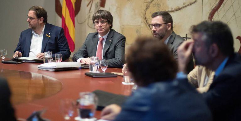 Catalan Premier Carles Puigdemont and Deputy Premier Oriol Junqueras (left) during a weekly meeting.