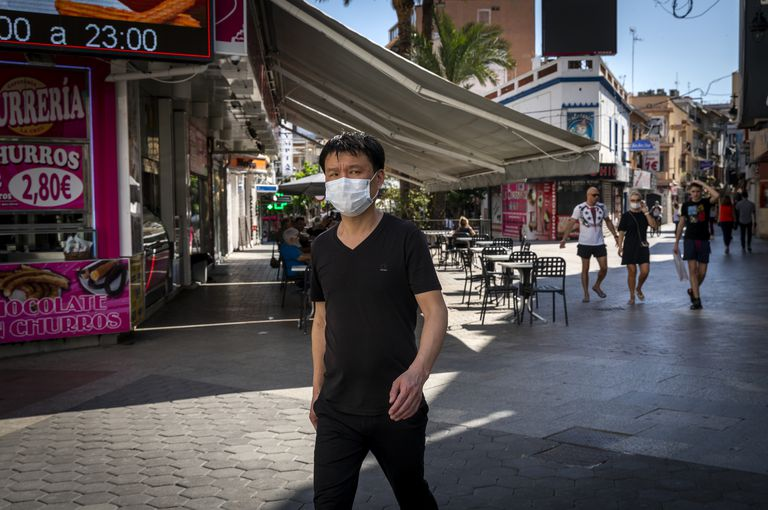A pedestrian with a mask in Benidorm, a popular tourist destination on Spain's eastern coast.