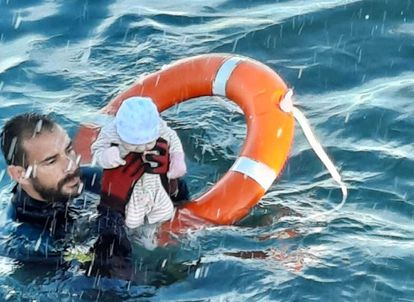 A Civil Guard diver rescues a baby from the water off the shore of Ceuta on Tuesday.