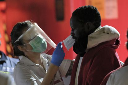Health workers attend to a group of migrants who arrived in the port of Arguineguín in Gran Canaria last April.