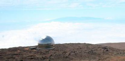 An artist's rendition of what the Thirty Meter Telescope would look like atop the Mauna Kea in Hawaii.