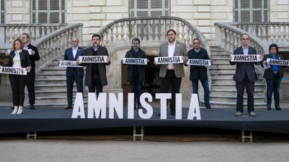 Jailed separatist leaders (l-r) Oriol Junqueras, Jordi Cuixart, Jordi Sanchez, Quim Forn, Carme Forcadell, Dolors Bassa, Raul Romeva, Jordi Turull and Josep Rull in a protest to call for pardons in February.