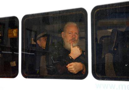 Julian Assange inside a police van after his arrest on April 11.