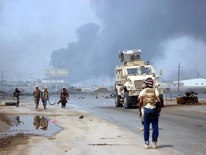 Yemeni government forces patrol an area taken by the Houthis.
