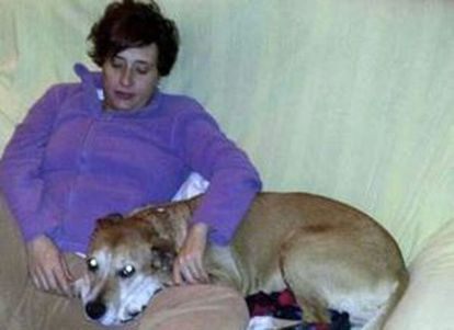 Teresa Romero pictured at home with her dog Excalibur.