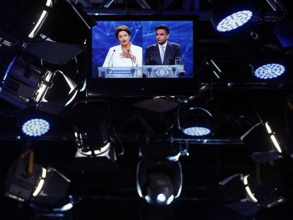 Rousseff and Neves in their first TV debate ahead of the runoff.