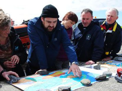 Historian John Treacy coordinates a search with a team of divers.