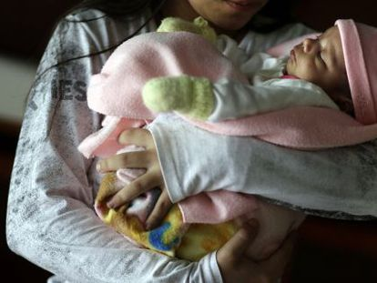 The 11-year old Paraguayan girl with her newborn.