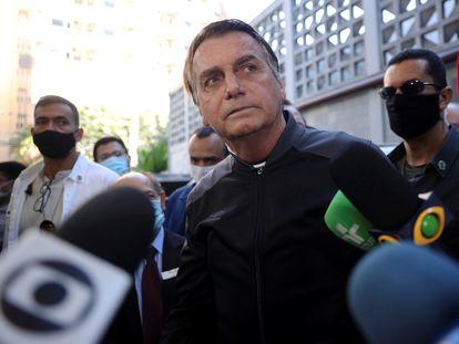 Brazil's President Jair Bolsonaro speaks to the media as he leaves Vila Nova Star Hospital, where he was treated in July.