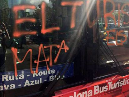 "The bus was sprayed with the words ""Tourism kills the barrio."""