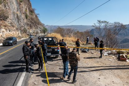 Members of the Zapopan municipal police cordon off the place where a body was dumped.