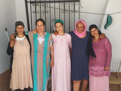 (l-r) Fatna, Saidia, Najiya and two other migrant workers from Morocco outside their home in Huelva province.