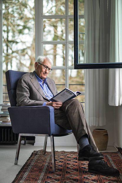 Jürgen Habermas reads in the living room of his home in Starnberg, near Munich.