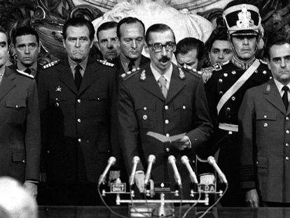 Jorge Rafael Videla (c) is sworn in as president of the military junta in Argentina in 1976.