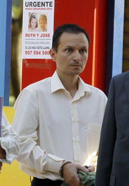 José Bretón, pictured in front of a poster seeking information about his missing children, José and Ruth.