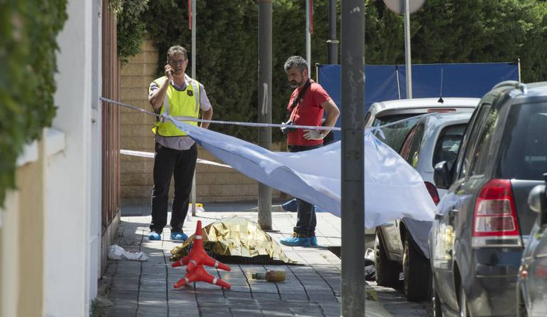 Catalan police officers at the scene of a murder.