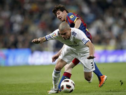 Real Madrid's Pepe tries to protect the ball under challenge from Barcelona's Leo Messi during an April, 2011 clásico.