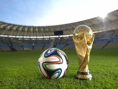Adidas' Brazuca ball and the World Cup trophy.