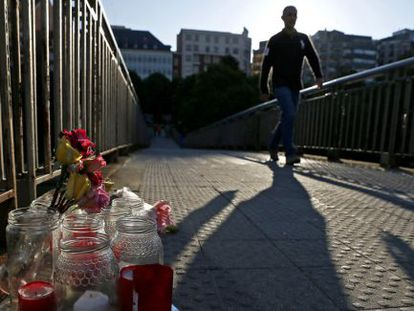 Flowers and candles mark the spot where Isabel Carrasco was shot dead on Monday.
