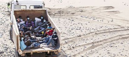 The migrants were driven away in a garbage truck.