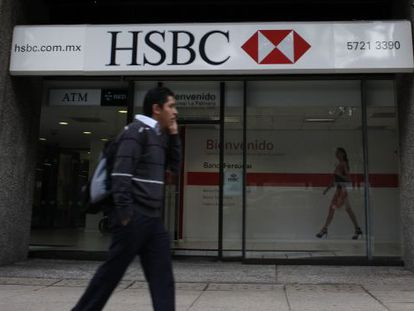 A man walks past a branch of British bank HSBC in Mexico City.