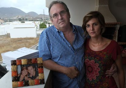 Joaquín Amills and his daughter alongside a photo and the case file of his missing son.