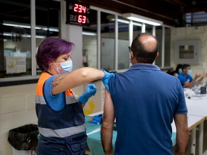 A man is given a shot of the Moderna vaccine in Seville.