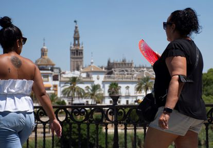 A woman fans herself in Seville in Andalusia.