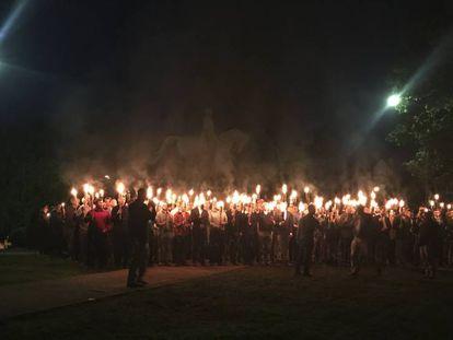 Dozens of torch-bearing demonstrators at Lee Park in Charlottesville, Virginia.