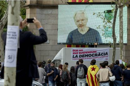 Julian Assange speaks to university students in Barcelona on Tuesday via videolink.