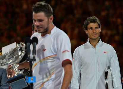 Rafael Nadal looks on as Stan Wawrinka delivers his winner's address.