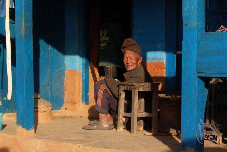 Taking it easy, a local shopkeeper waits for custom.