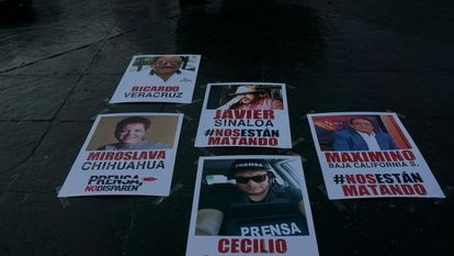 Posters displaying images of reporters who have been killed in Mexico.