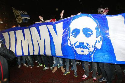 Fans of Deportivo Coruña pay tribute to the man who died in the street fight.