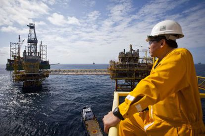 A Pemex worker observes a platform at the Ku-Maloob-Zaap offshore field in Mexico.
