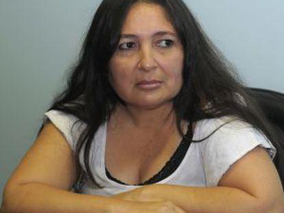 Narcisa Delacruz speaks to reporters on Tuesday.