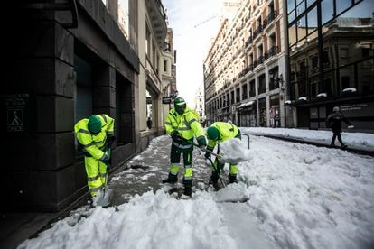 Workers clearing snow in Madrid.