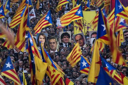 Protesters wave flags in support of Catalan independence and carry photos of the separatists leaders on trial.