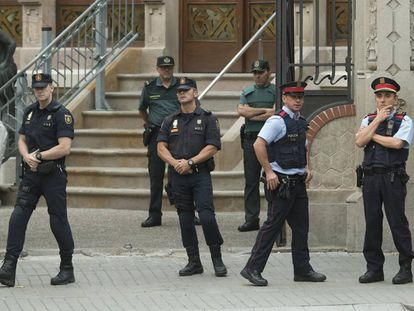 Officers with the Civil Guard, National Police and regional Catalan Mossos d'Esquadra forces in Barcelona.