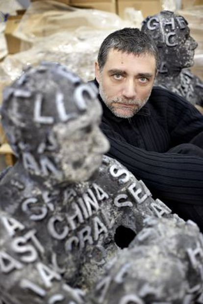 The sculptor Jaume Plensa poses with some of his work.