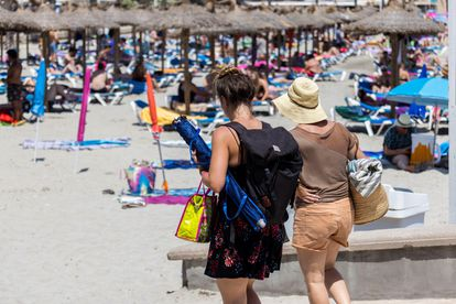 Tourists on Peguera beach, in the city of Calvià on the island of Mallorca.